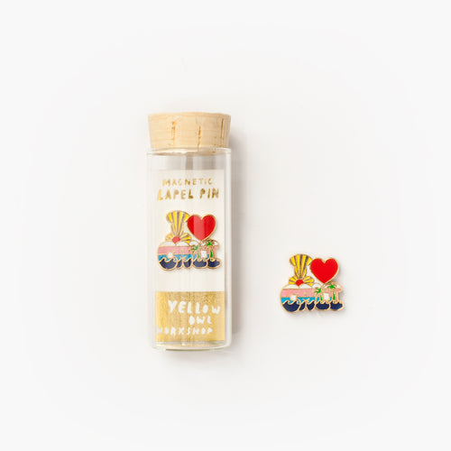 22k gold gilt 'I Heart Cali' magnetic enamel lapel pin in a glass vial with cork packaging