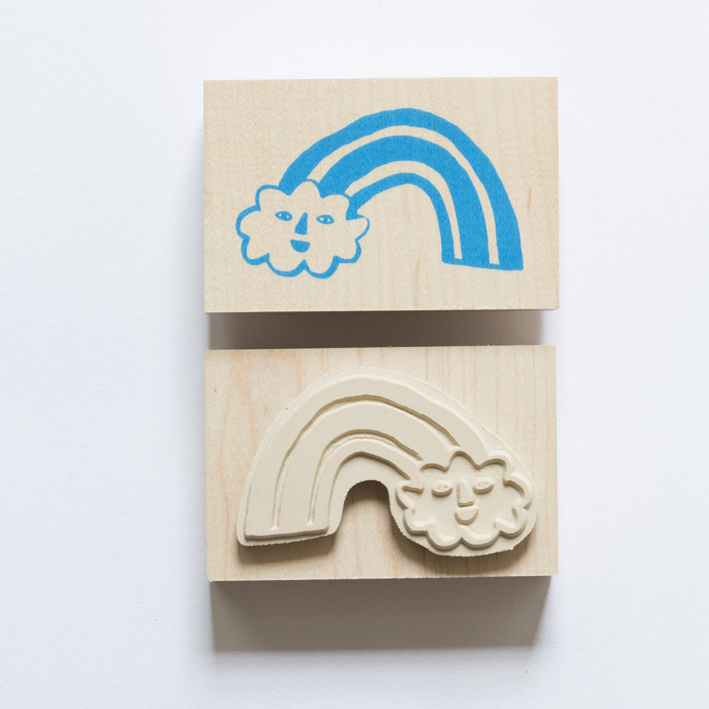 Wood mounted rubber stamp of a rainbow and cloud illustration