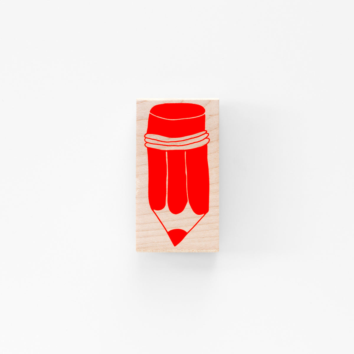 Wood mounted rubber stamp featuring a bright red pencil graphic