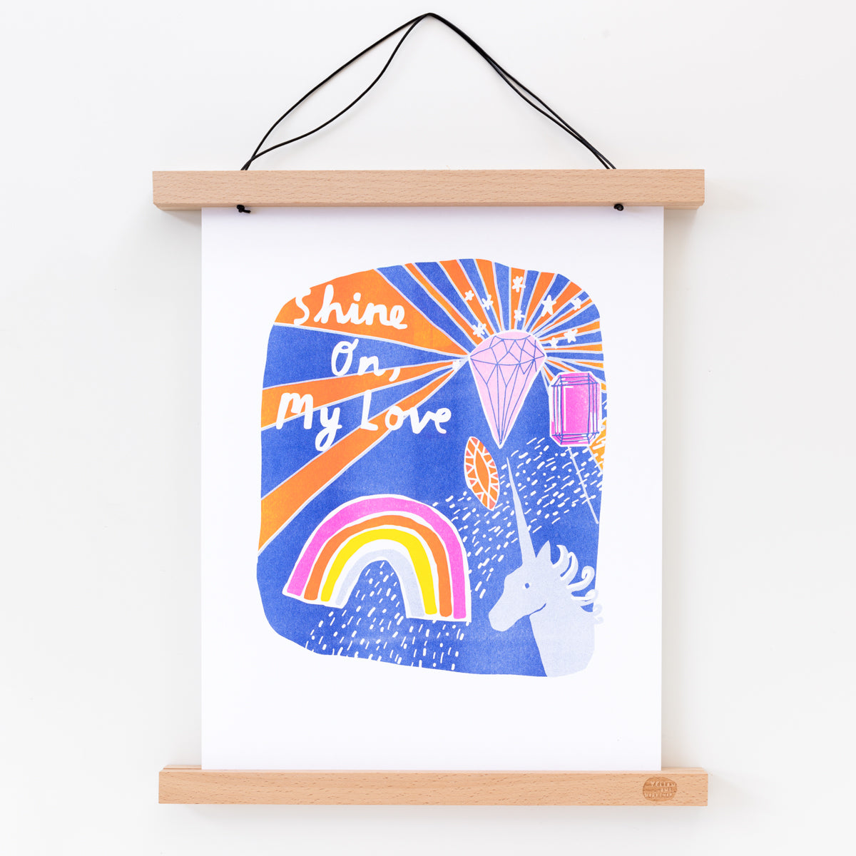 "Hand printed Risograph art print of a unicorn, rainbow and gems with ""Shine On, My Love"" script"