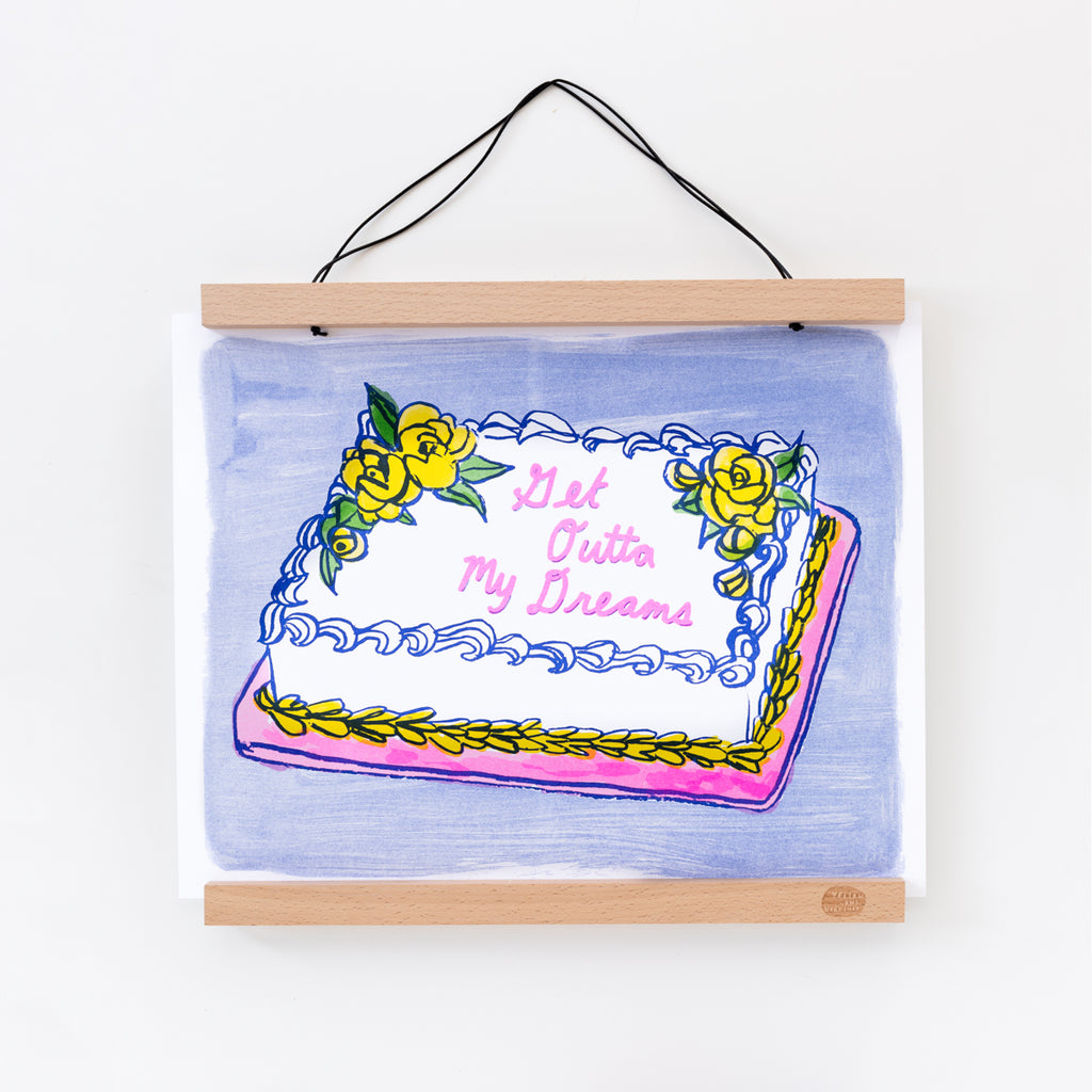 "Risograph art print of a sheetcake with ""Get Outta My Dreams"" text"