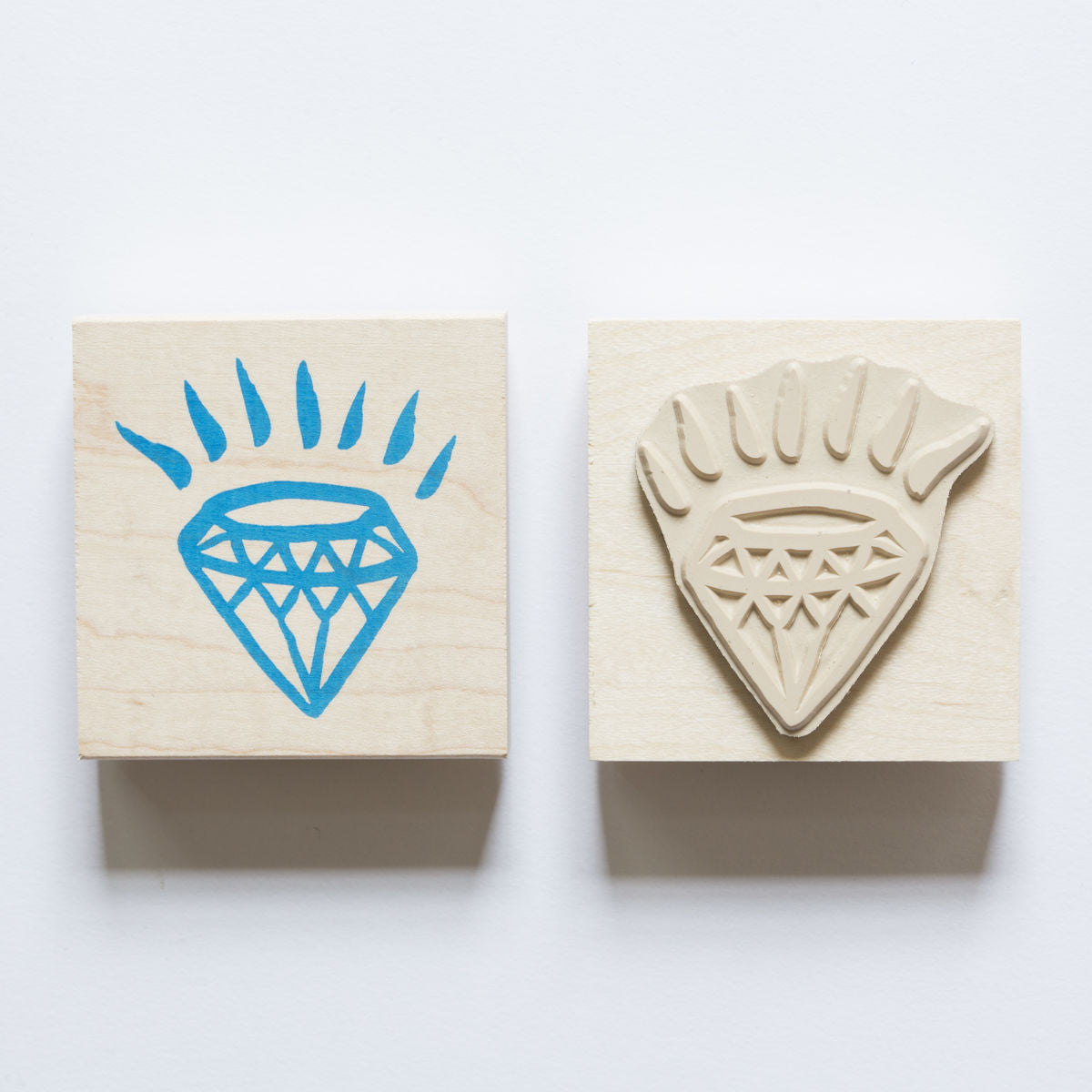 Wood mounted rubber stamp of a glowing diamond.