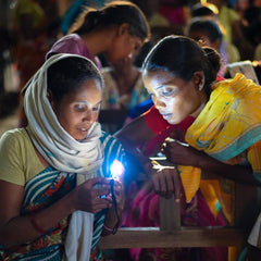 two ladies listening to solar audio bibles with led lights