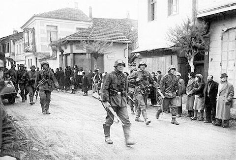 picture taken of Kamala greece during world war 2 with soldiers marching down the street.