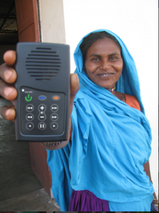 photo of woman holding solar audio bible