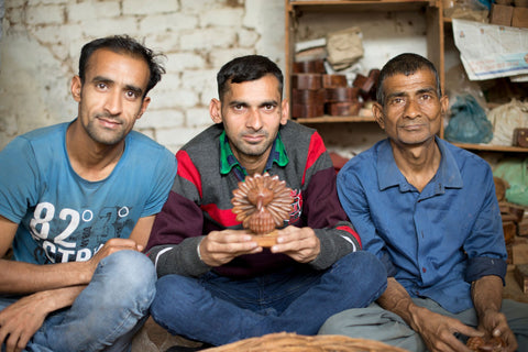 Quasim (far left), Sachin (middle), and Mukul (far right), have been wood carving artisans for over 10 years in North Central India