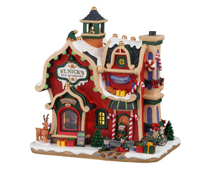 Lemax 95530 St. Nick's Elf Academy, Standard Lighted Building- Gift Spice