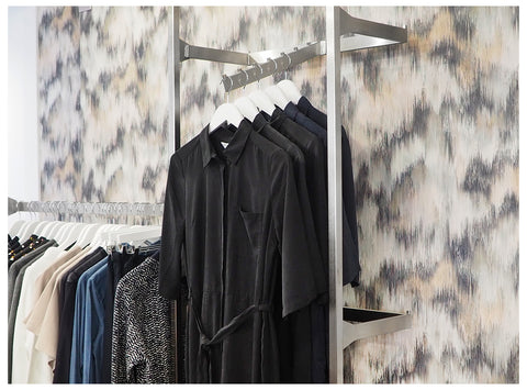 The Black Edition wall behind the clothes rails of LoLo + Co