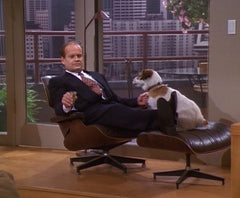 Frasier Crane sits on the Eames lounge chair with Eddie the dog