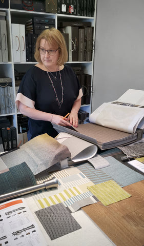 Wendy our Soft Furnishing designer in the showroom fabric library