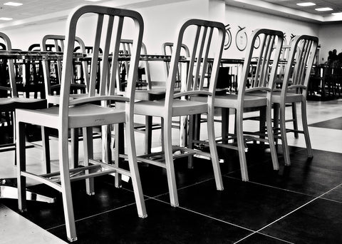 Aluminium Emeco chairs lined up in the factory - WB Jamieson