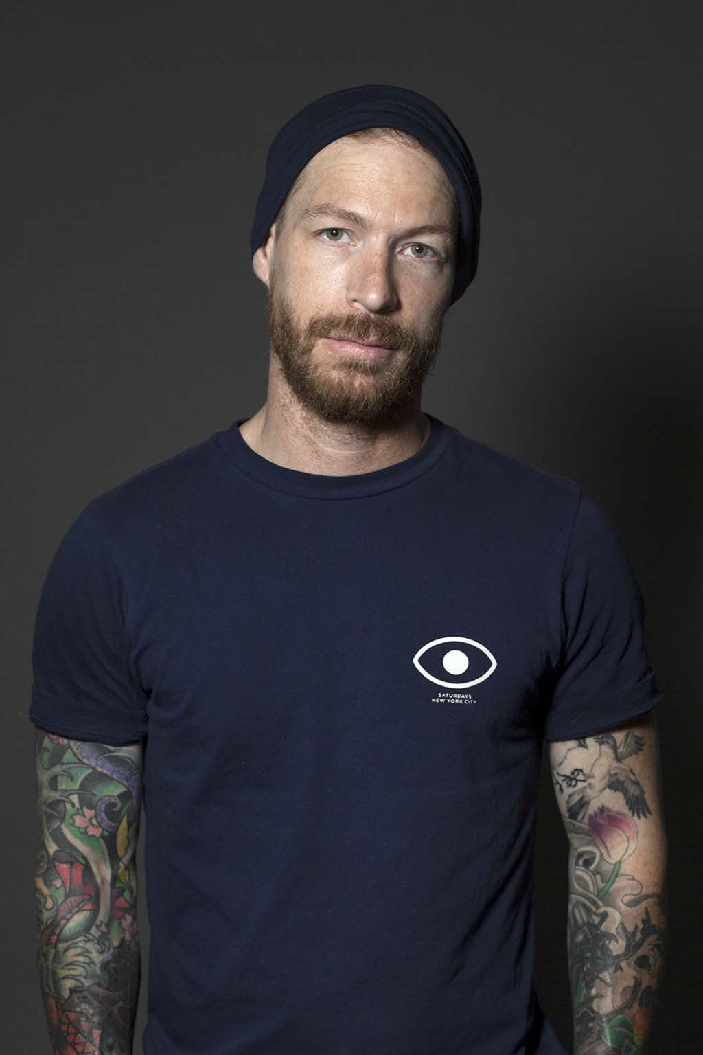 Navy Men's GEEG Beanie featured on Man with Tattoos