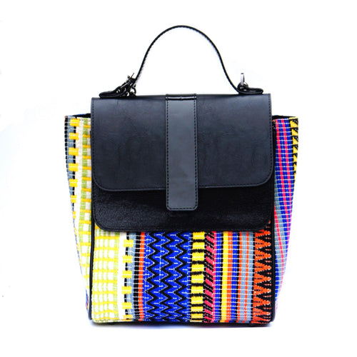This multi colored structured satchel has a faux leather flap pocket in the front and on top. The interior has cotton lining with a zip pocket. This satchel comes with an additional long chain handle with shoulder support so you could cross sling it too