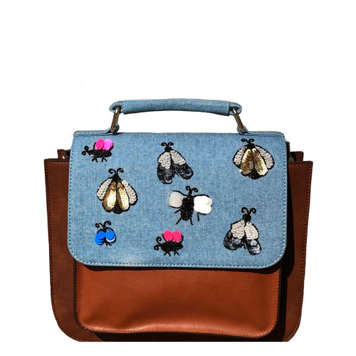 Tan faux leather structured satchel with hand embroidered beetles on the denim flap