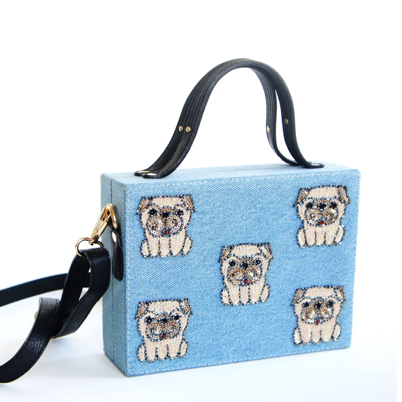 Black faux leather or denim bag with hand embroirdered sequin puppies. This bag has a lush velvet lining and a majnectic closure on top. The metal chain can be used to sling the bag.