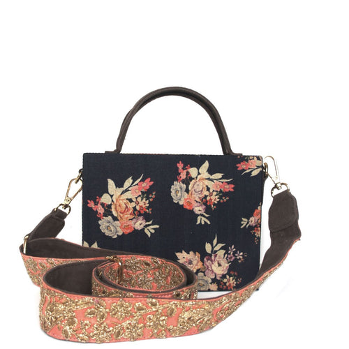 Structured black floral print briefcase bag with gold metal thread hand embroidered cross body strap Lush black velvet interior lining Magnetic closure on top