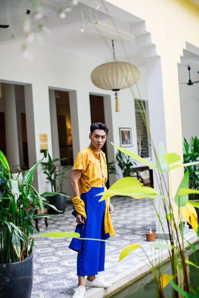 Miga wears royal blue culottes from the Plant Kween x tonlé collection with a yellow gender expansive top