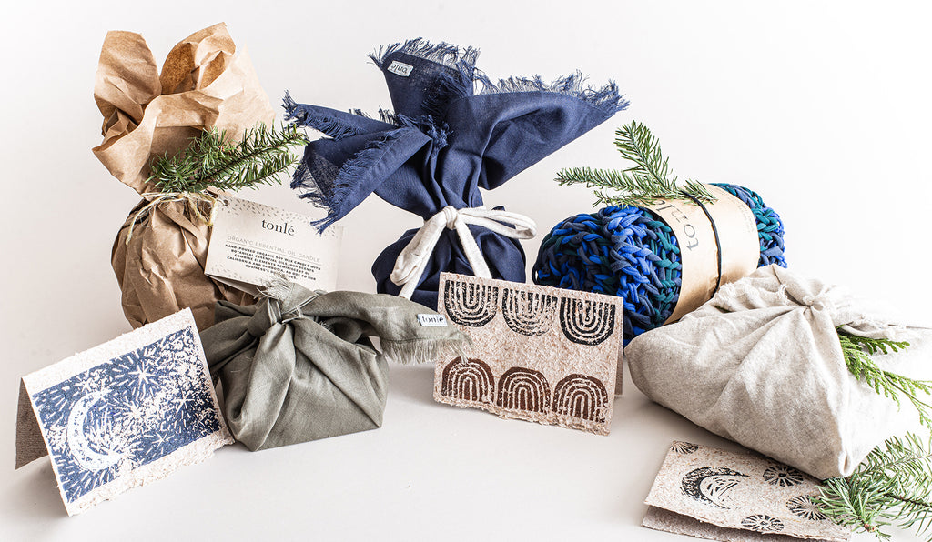 A collection of tonlé gift items in sustainable holiday gift wrap