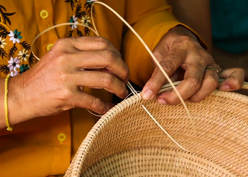 Rattan weaver with Manava Cambodia making a laghu basket
