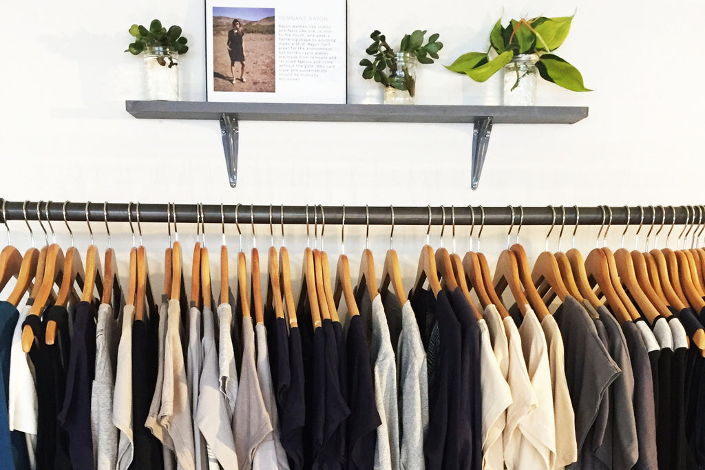 image of garments hanging on a rack - tonlé open closet