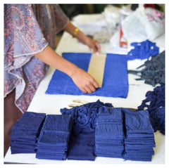 Fabric deemed unusable by large manufacturers is strategically cut into strips to be made into tonlé garments.