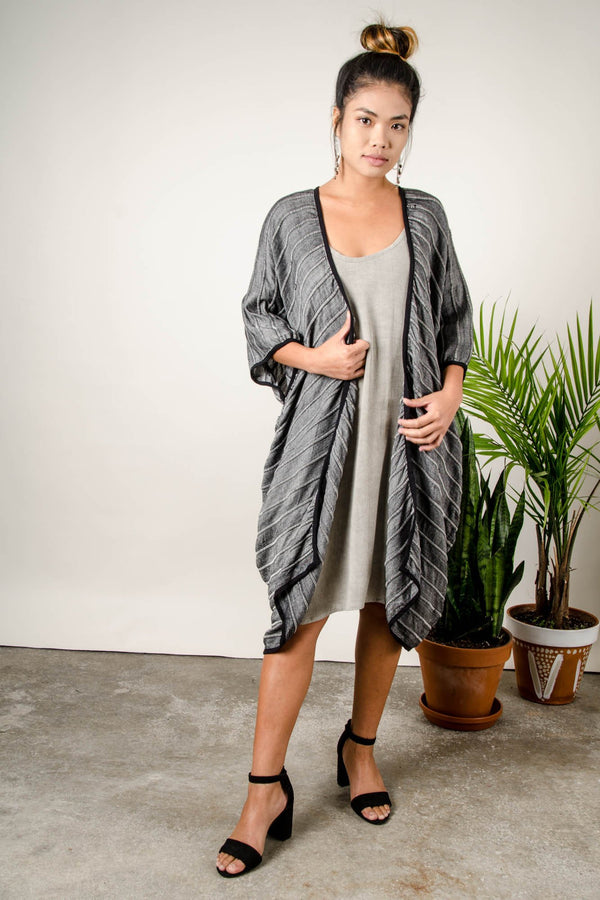 Our sustainably made handwoven long duster vest can be layered over many looks.
