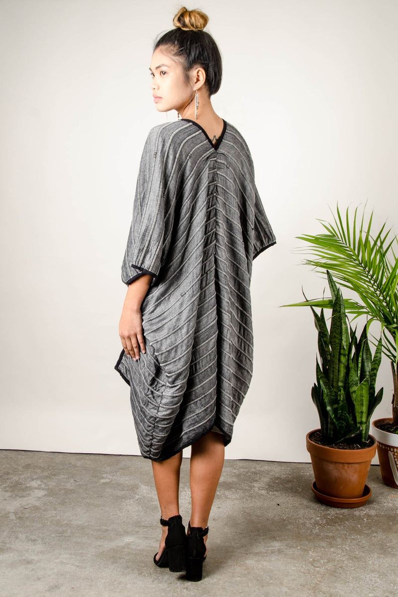 A back view of the ethically made Takeo long duster vest shows the elegant drape of the garment.