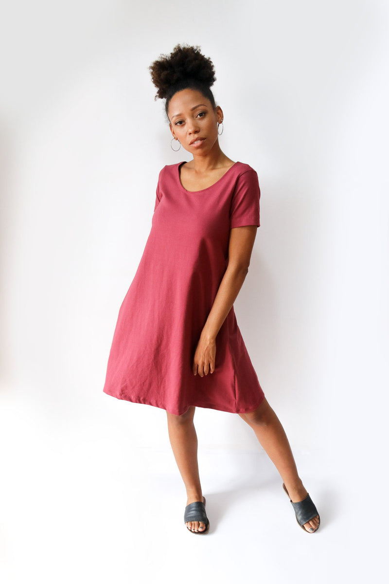 The A-line t-shirt dress, seen here in rosewood, is made from reclaimed jersey as part of our unique zero waste process.