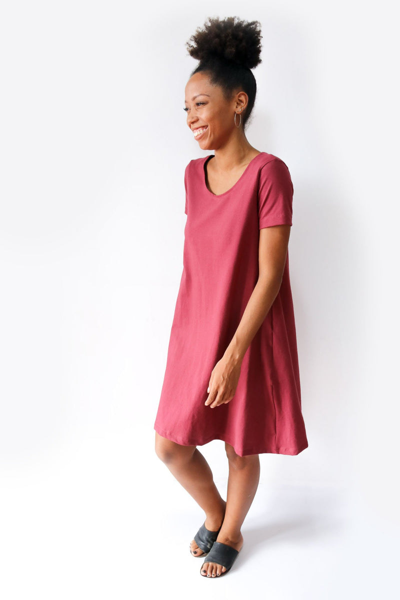 A side view of our A-line t-shirt dress shows the sleeve length and how the drape of the dress falls. This dress is designed to be maternity friendly clothing.