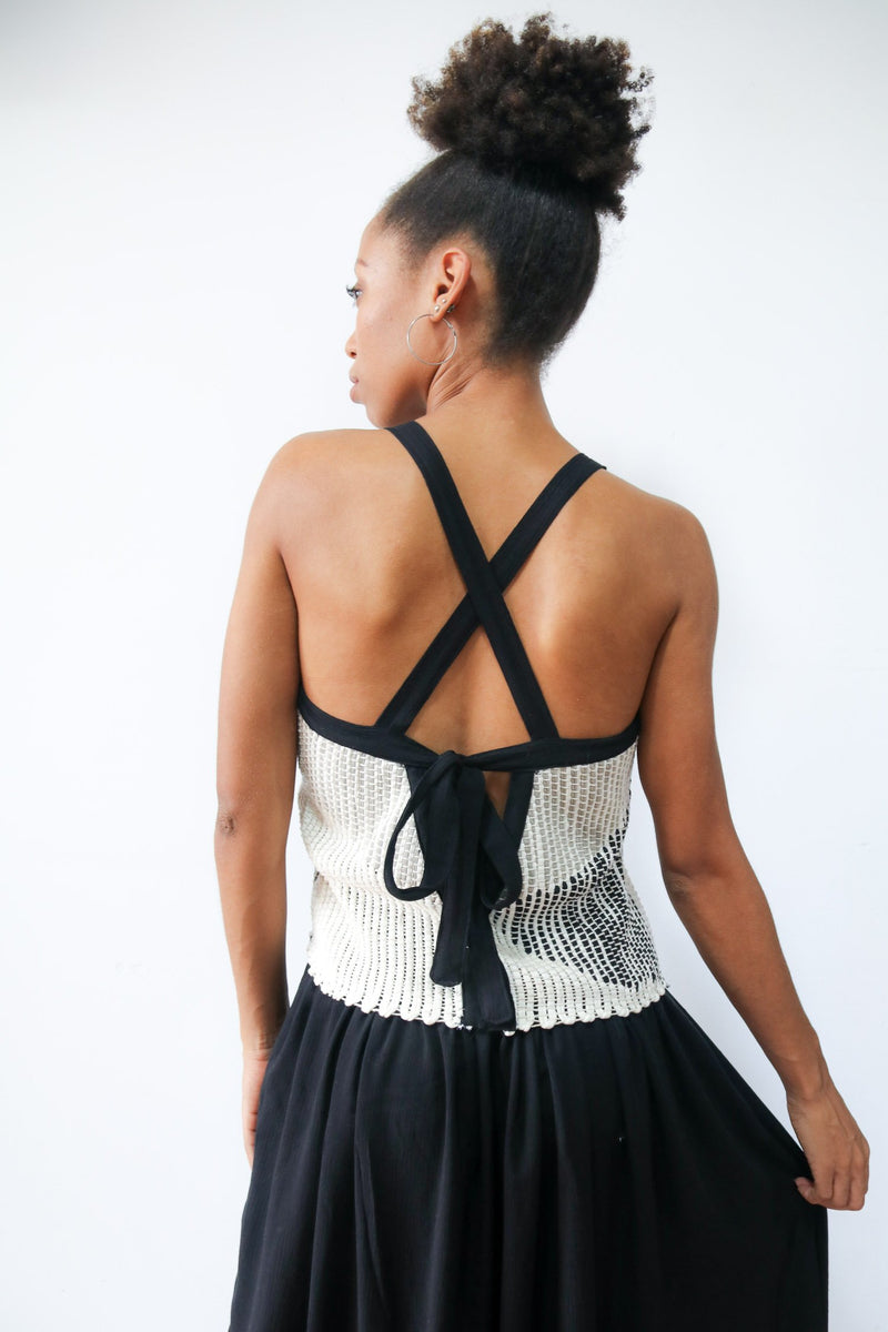 A back view of our Alice dress that shows the cross straps and bow tie closure.
