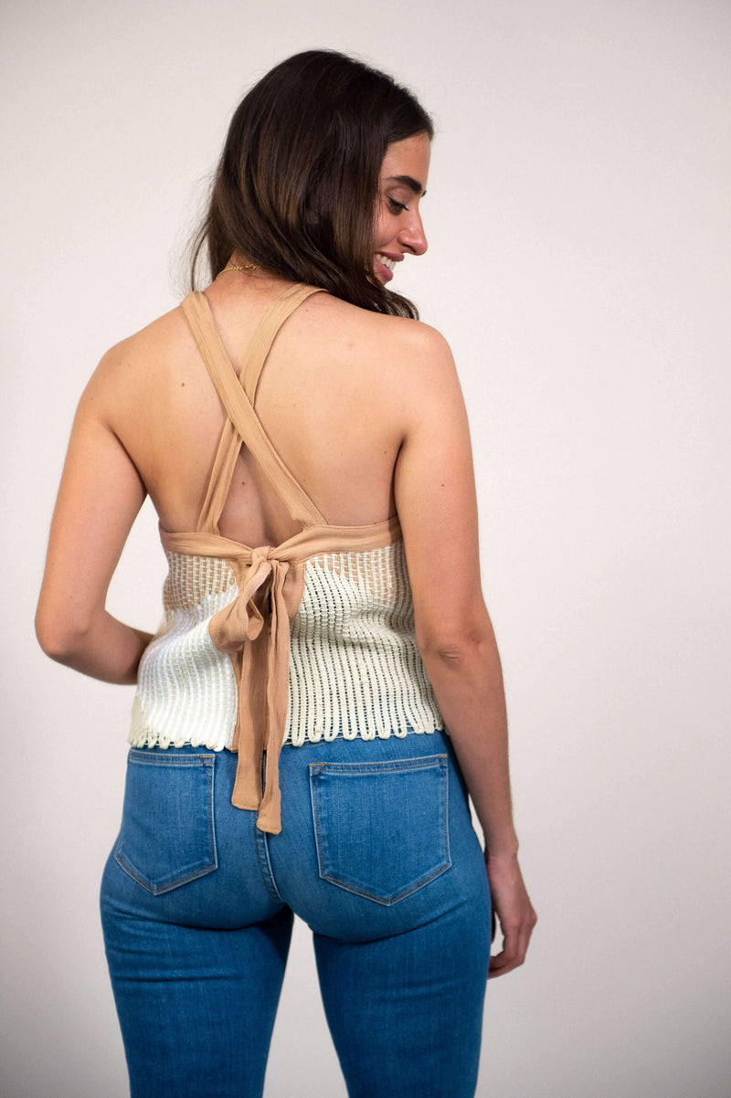 A back view of our circular fashion Alice top that shows the cross-back straps and tie closure.
