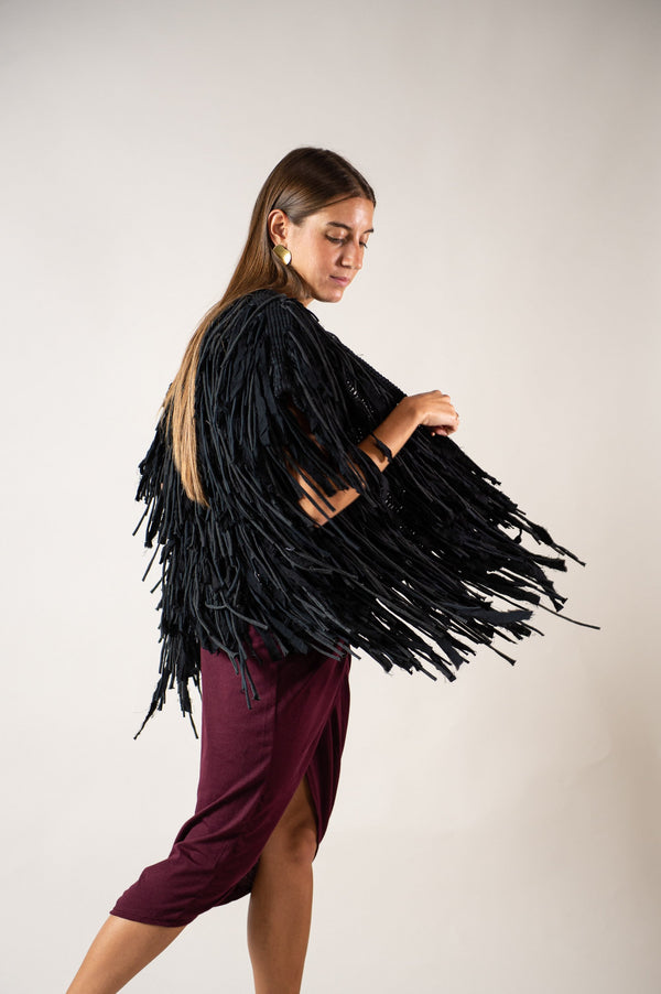 Super fun to twist and turn in, the Amara vest, seen here in raven, is a true show stopper.