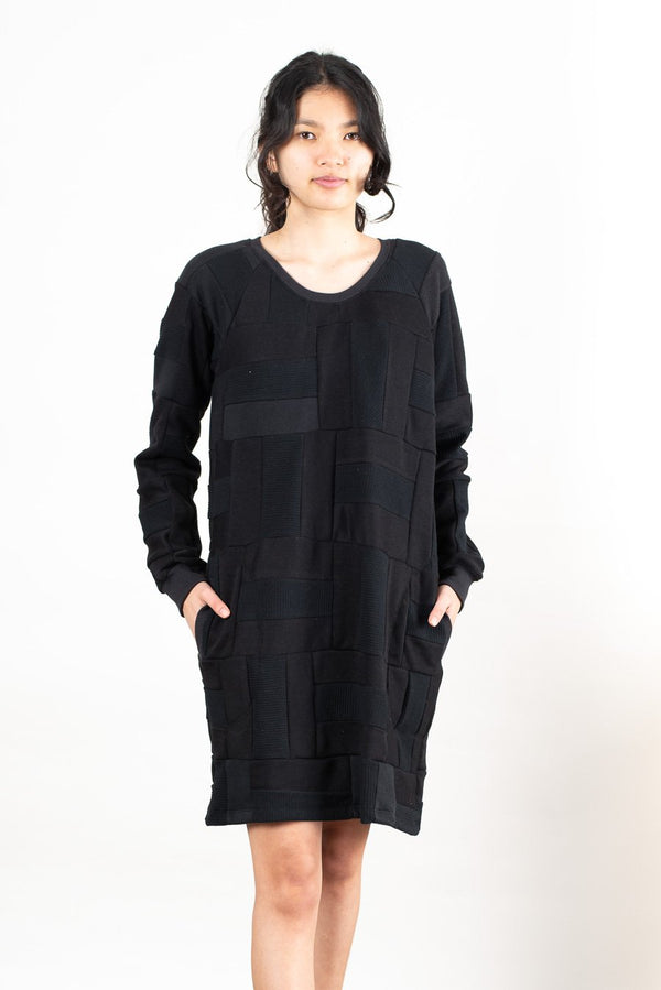 There are two generous pockets on our sweatshirt dress, seen here in black.