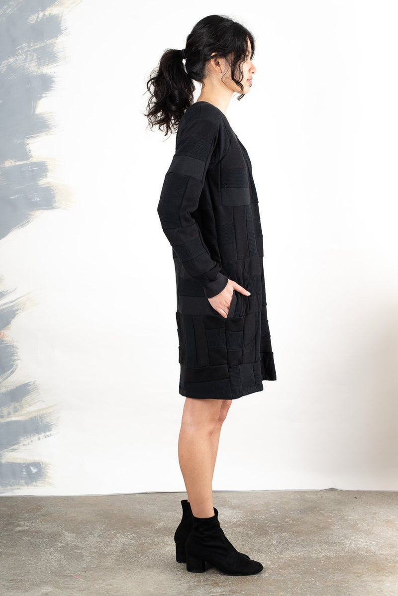 Super cozy, and also chic, the sustainably made sweatshirt dress can be styled up with heeled boots.