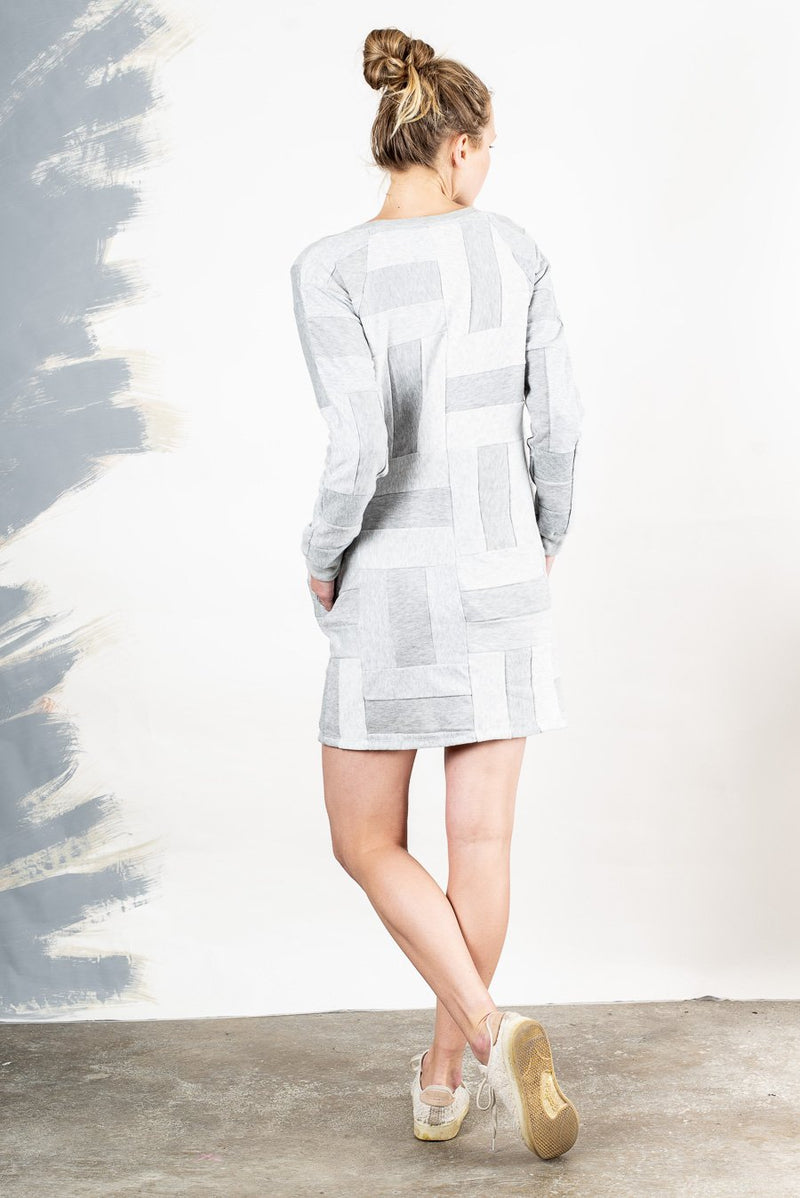 Back view of our Angkor sweatshirt dress that shows the patchwork pattern used throughout this zero waste fashion piece.