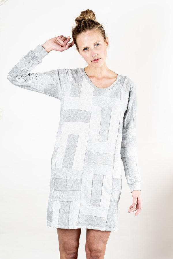 Our Angkor sweatshirt dress, seen here in grey, is sustainably made from small sweater fleece scraps in a zero waste process.