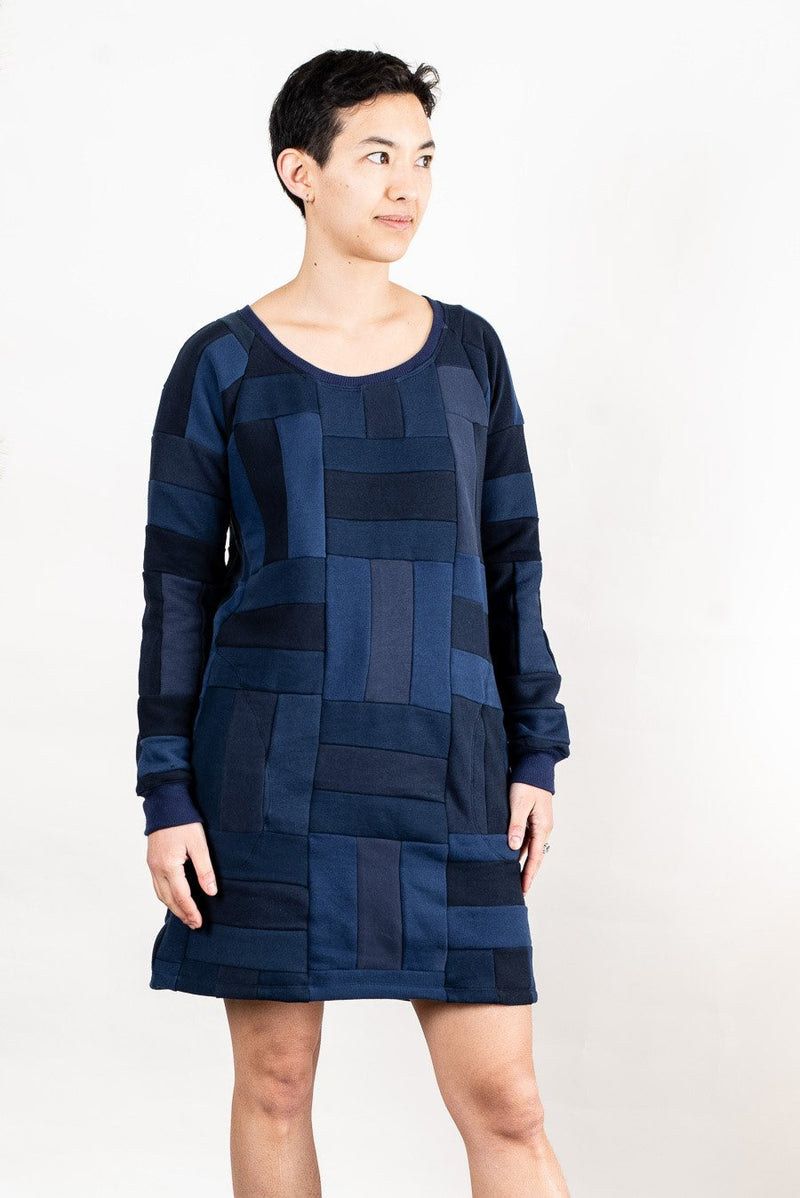 A gender neutral style, our Angkor sweatshirt dress, seen here in navy, can be worn alone or as a longer layer over pants.