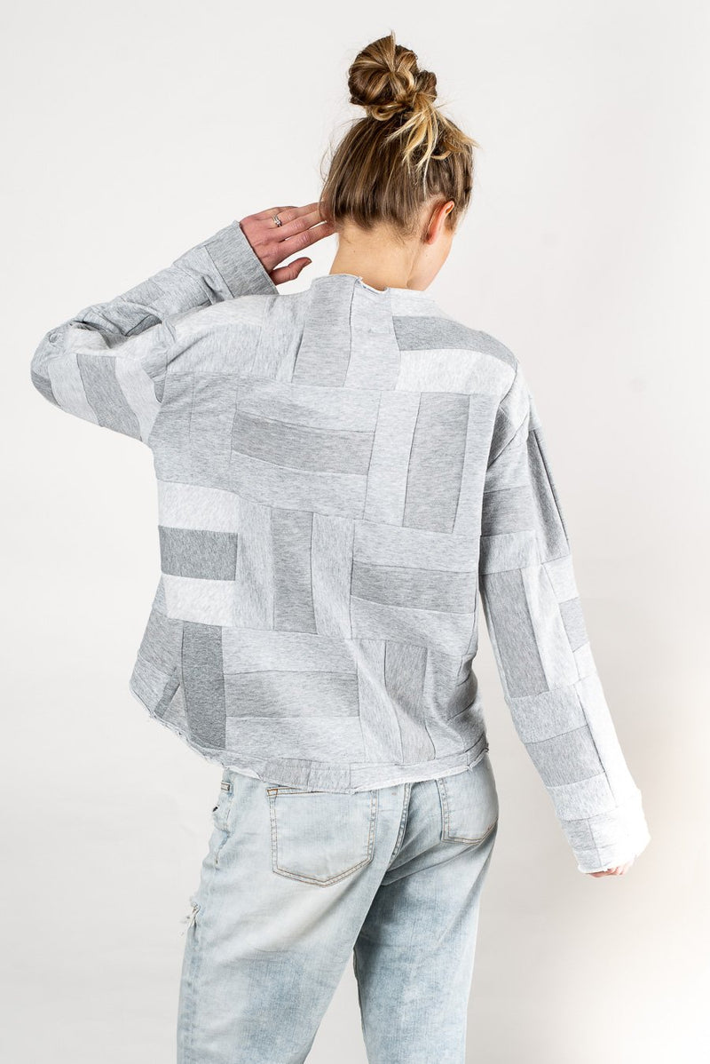 Back view of our Angkor sweatshirt that shows the patchwork pattern used throughout this zero waste fashion piece.