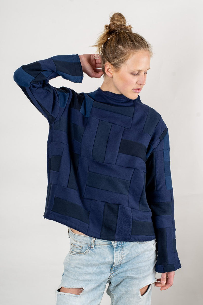 Varying shades of color in our Angkor sweatshirt, seen here in navy, highlight the beauty of the remnant fabrics it is made from.