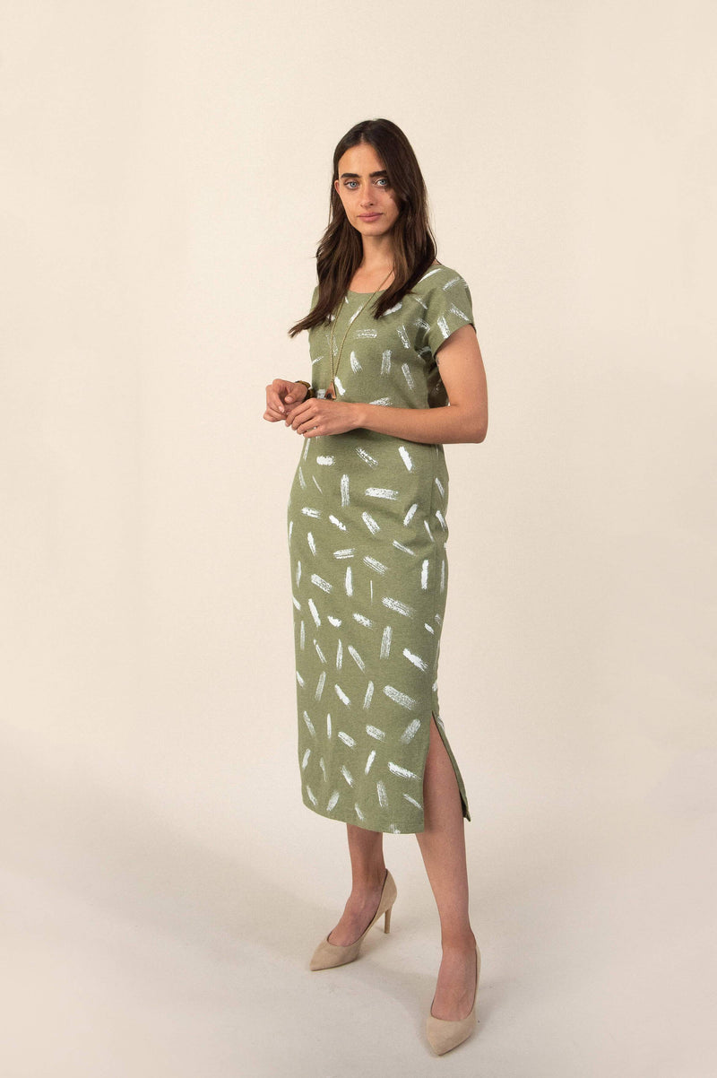 Our sustainably made Anja dress, seen here in sage with a dash print, can be styled with heels and bold accessories for an inspired evening look.