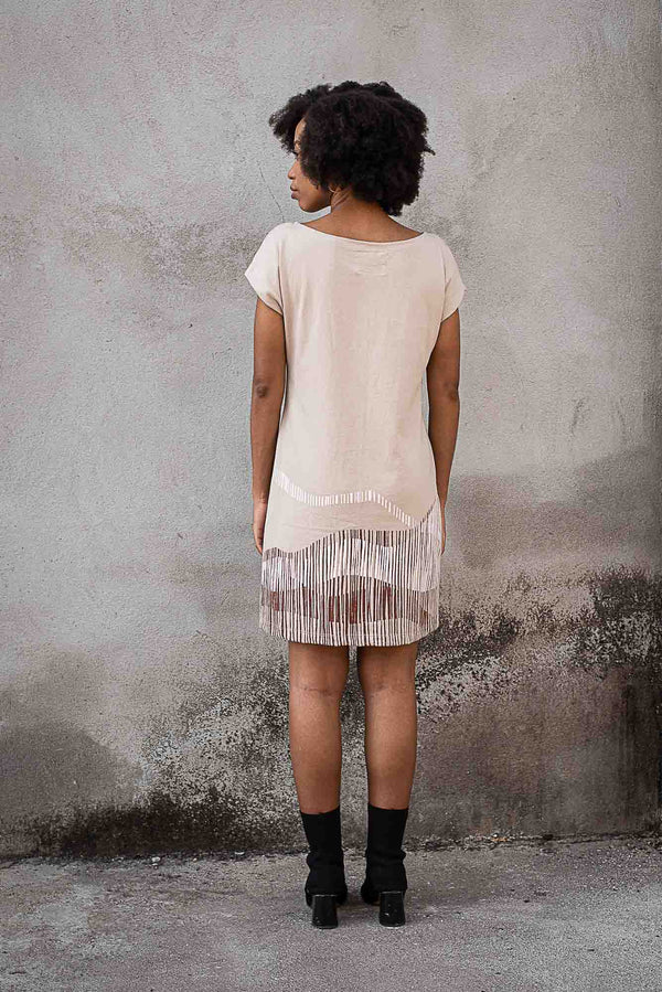 A back view of our sustainable fashion t-shirt dress in khaki with our mountain range print.