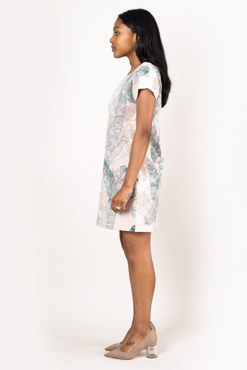 A side view of our classic, sustainably made t-shirt dress with a banana palm print.