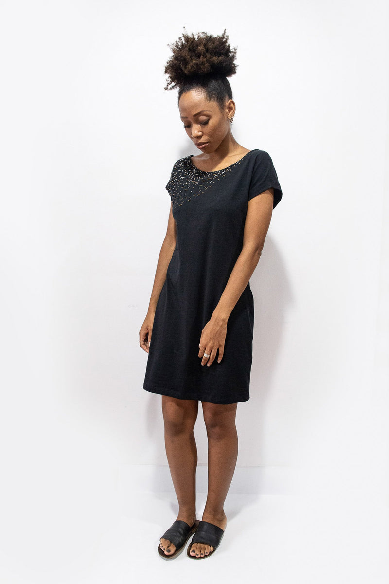 Our fair fashion t-shirt dress can be styled casually with slides, as seen here, or layered over pants or leggings.