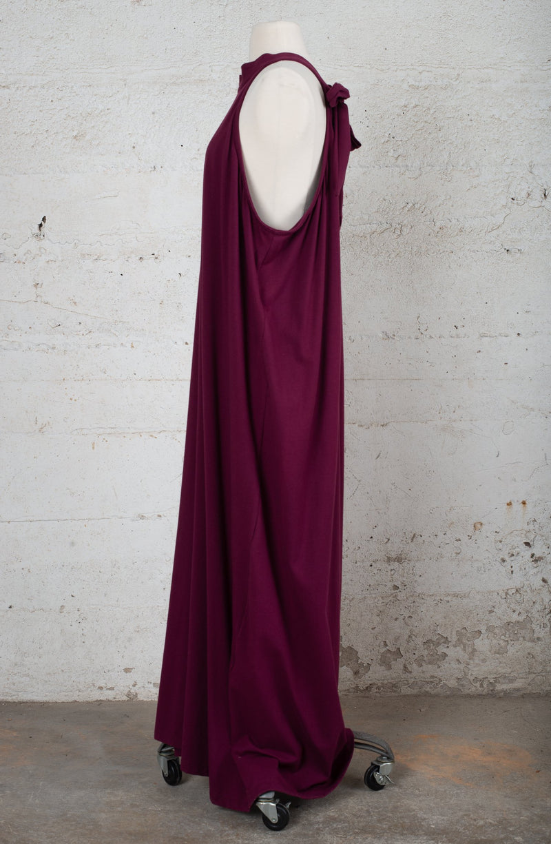 Side view of an ethically-made, pre-owned dress.