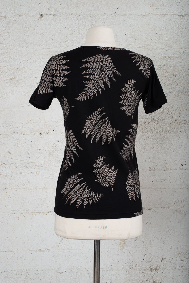 Back view of a pre-worn t-shirt for sale on our circular fashion trade-in, consignment-like platform.