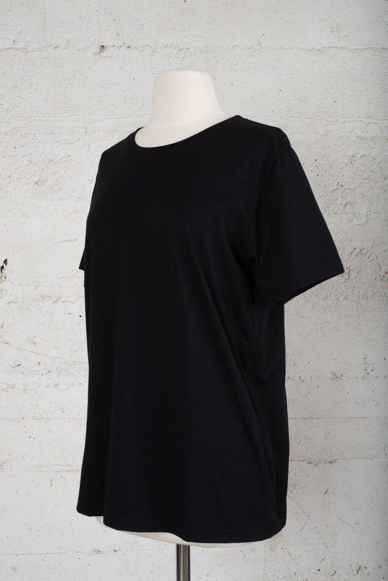 Front, angle view of a sustainable fashion secondhand t-shirt.