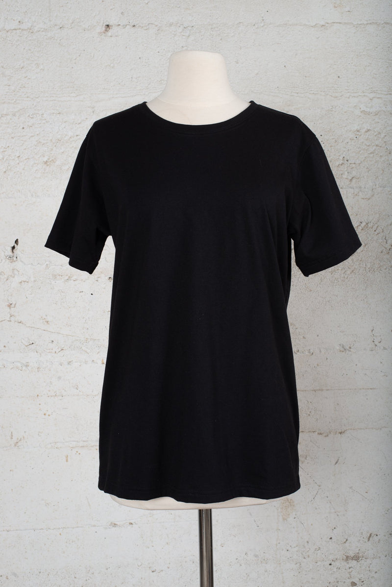 Front view of a circular fashion resale t-shirt, made from reclaimed cotton jersey in our zero waste process.