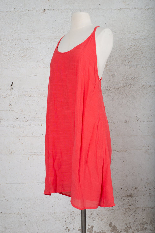A side angle view of the cross-back dress on our sustainable fashion, secondhand sale site.
