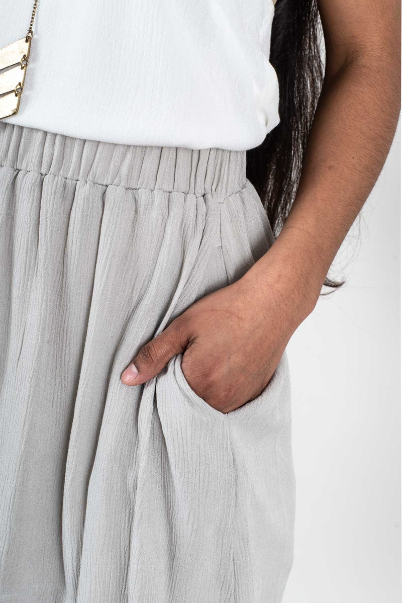 A detail shot of our culotte shorts that shows the side pocket. The culotte shorts are part of our circular fashion system.