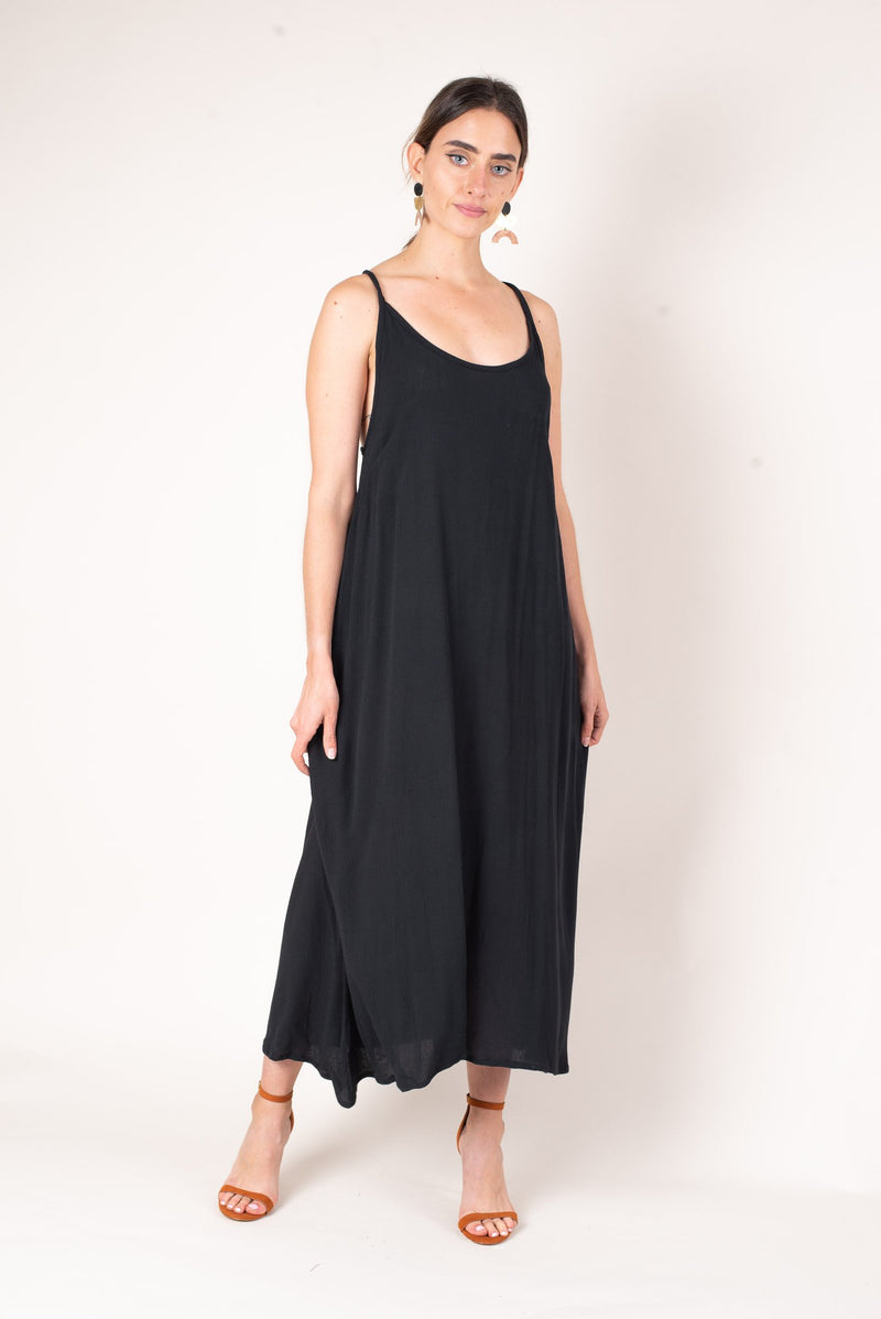 Our zero waste dara midi dress, shown here in black, is made from soft reclaimed cotton crepe.
